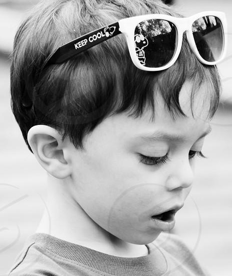Boy child sunglasses serious  photo
