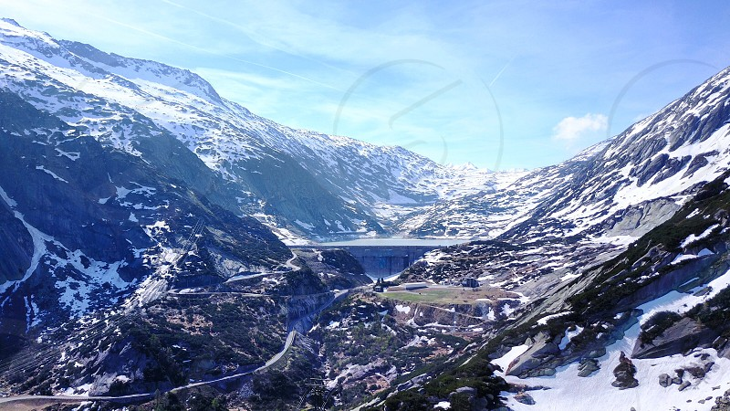 Dam water alpes mountains snow switzerland grimselpass  photo
