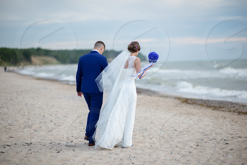 Bride and groom walking outdoor photo