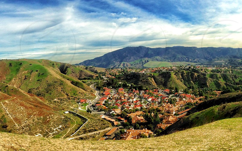 Mountain mountains hill hills vista view neighborhood town village bright sunny valley California southern green houses photo
