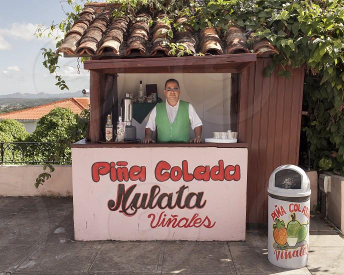 Piña Colada Mulata Viñales Cuba drink coconut pineapple landscape bartender  photo
