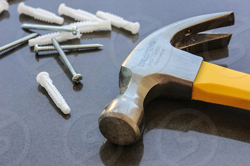 hammer and screws on table photo