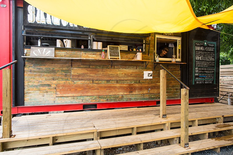 brown wooden store with yellow tarpaulin photo