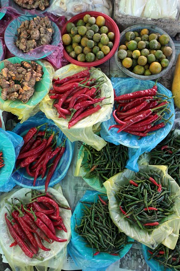 asia borneo brunei asia food chili red chili spices ingredients hot spicy red chili red peper plate portion southeastasia market photo