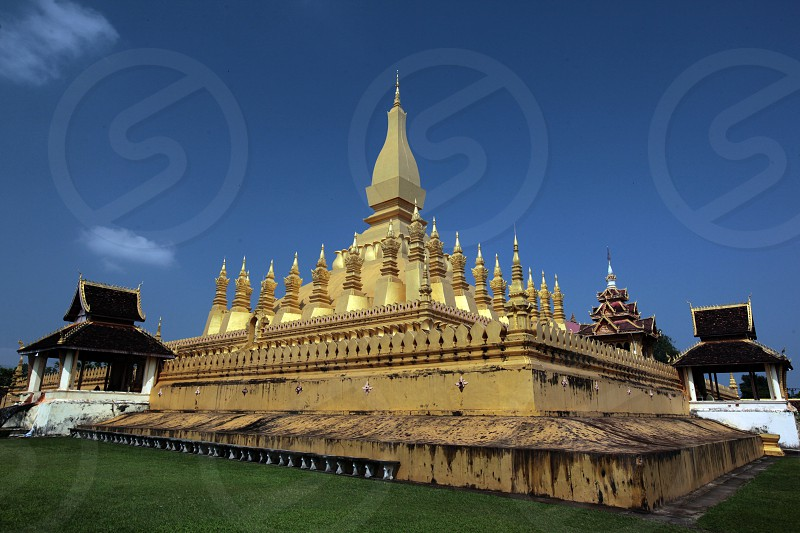 the Wat That Luang in the city of Vientiane in Lao in Souteastasia. photo
