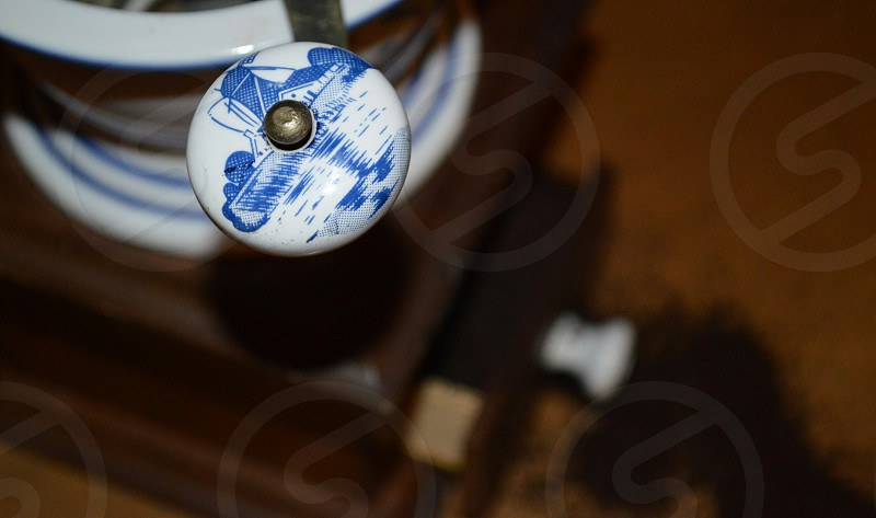white and blue round lever holder photo