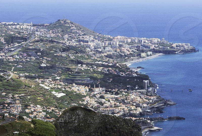 view from Miradouro do cabo Girao 550 meters above sea level to the skyline of funchal capital of madeira photo
