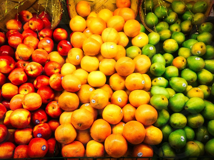 oranges and apples on display photo