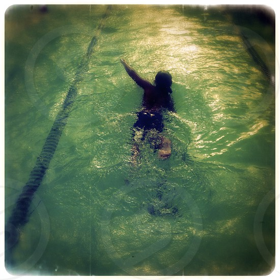 boy swimming in a pool photo