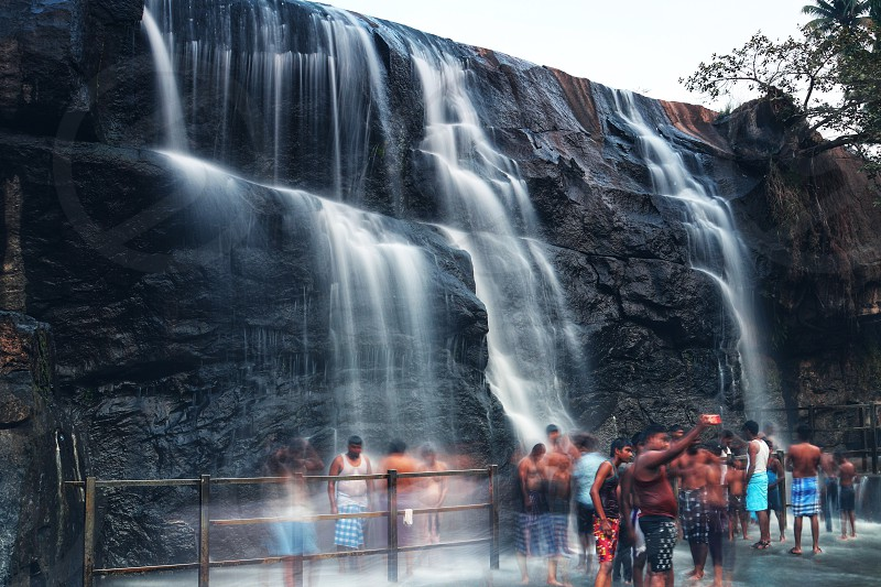 A beautiful water falls and people  photo