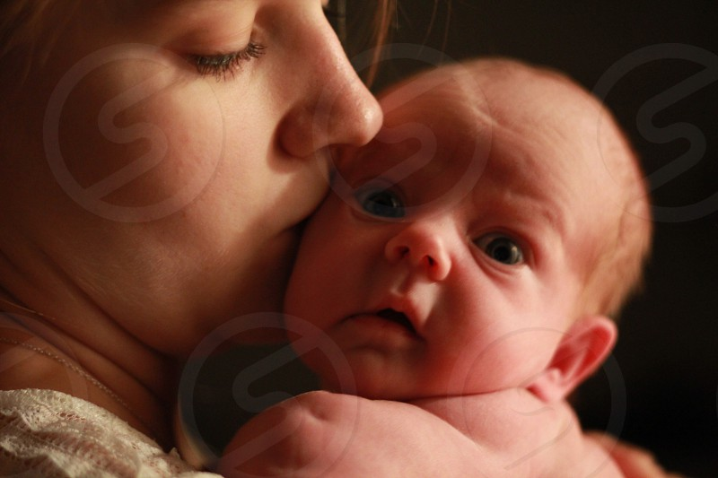 woman kissing baby photography photo
