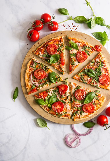 Overhead view of vegetarian pizza with fresh ingredients photo