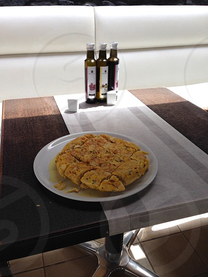 Spanish omelette food cooking dining recipe eggs potatoes onions peppers olive oil photo