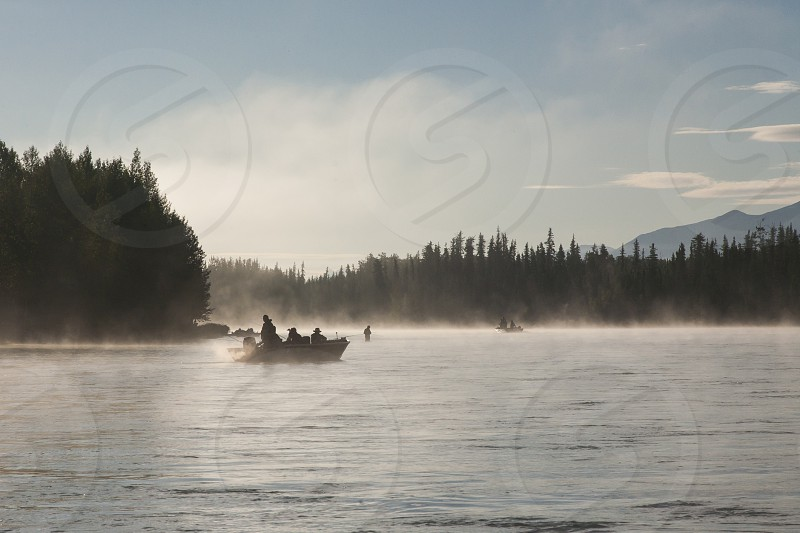 Foggy fishing morning on the Kenai River in Alaska. photo