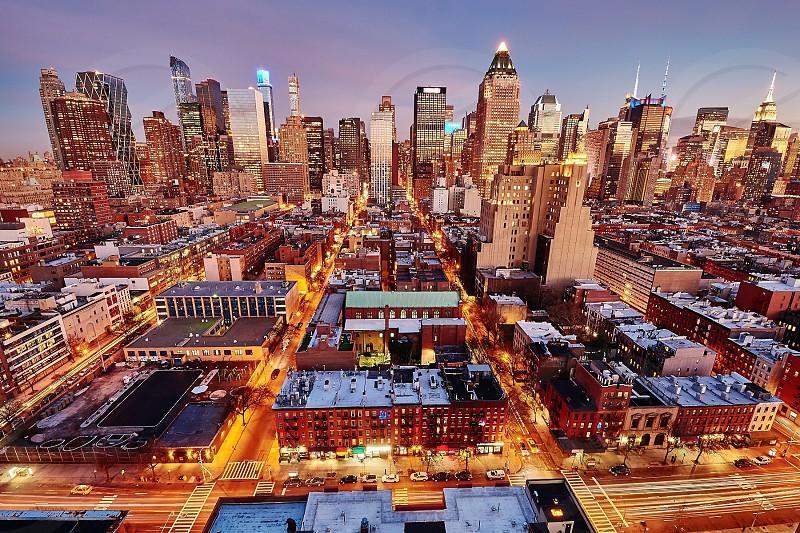 city landscape with lights under blue sky photo