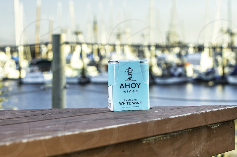 Ahoy wine with boats in harbor in background photo
