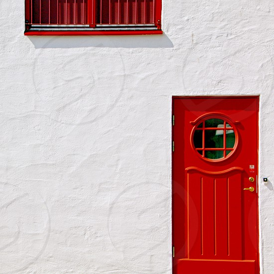 Red door window house white plastered facade wall photo
