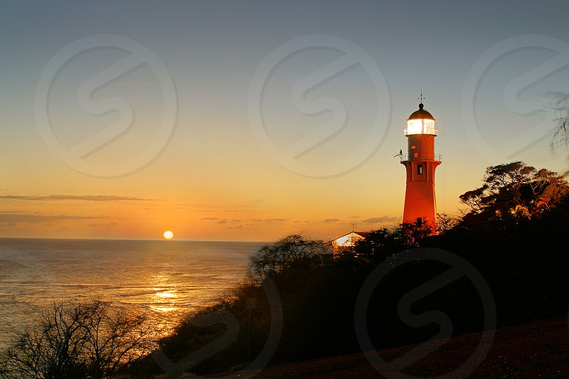 The Diamond Head Lighthouse at Sunset in Honolulu Hawaii. photo