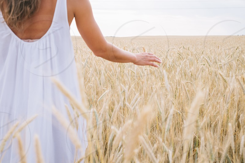 woman in white tank dress on grains during daytime photo