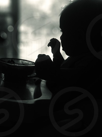 baby child toddler kid silhouette dinner meal eat highchair childhood photo