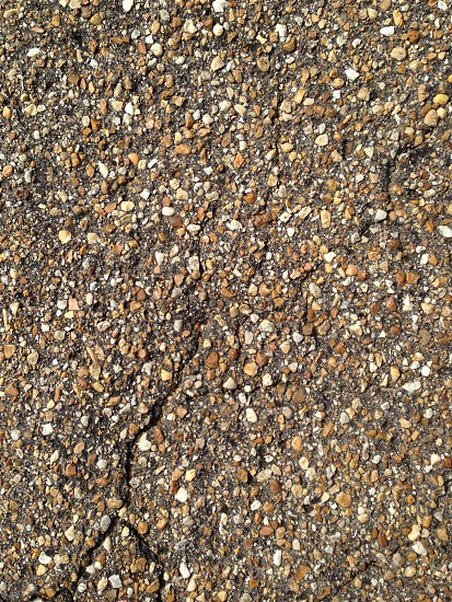 Gravel street road asphalt crack pebbles photo