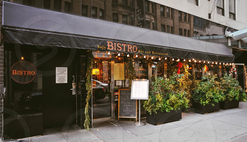 saju bistro restaurant nyc with black awning front photo