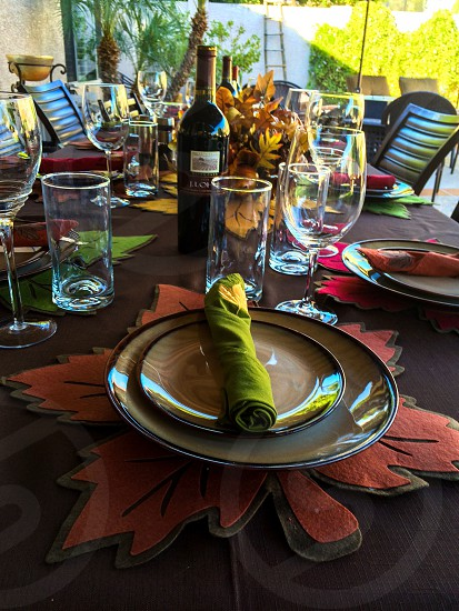 green table napkin on plate near drinking glass photo