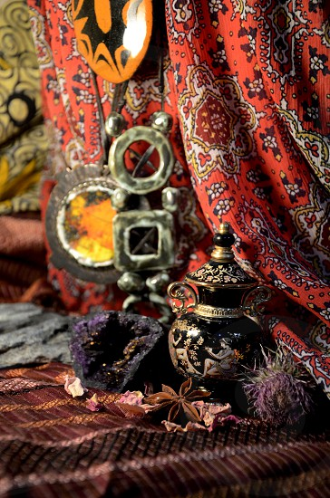 Bohemian Style Still Life with Vibrant Colorful Cloth Crystal Spices and Art photo