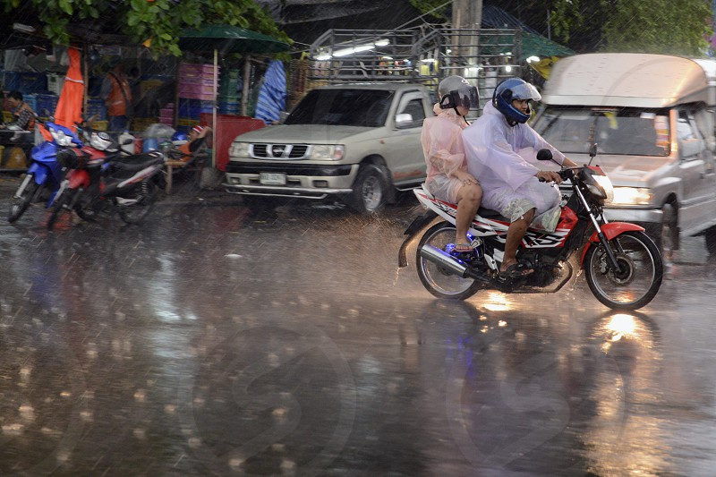 a motobike by rain the Siam square aerea in the city of Bangkok in Thailand in Suedostasien. photo