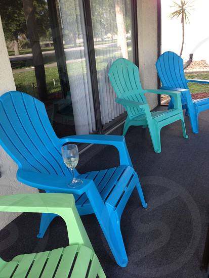 Colorful Adirondack Chairs on lanai   photo