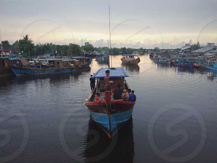 fisherman fisherman ship harbour human interst riverbank human photo
