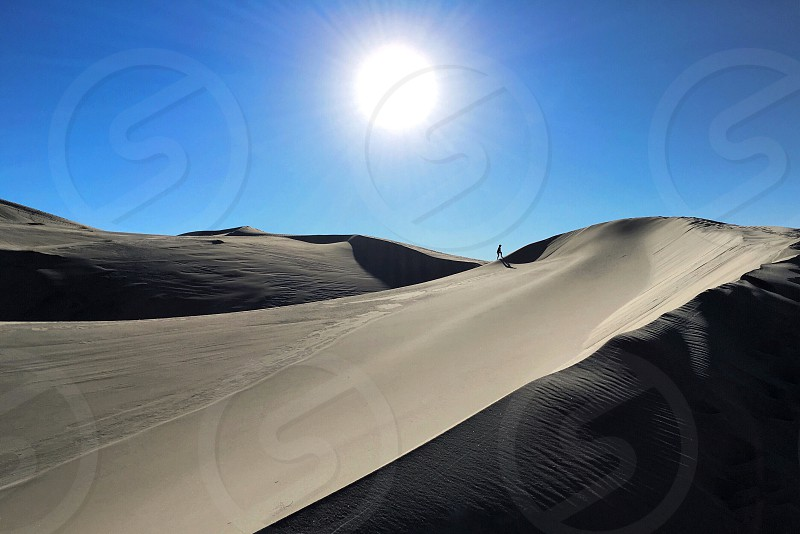 Exploring the Eureka Dunes in Death Valley. photo
