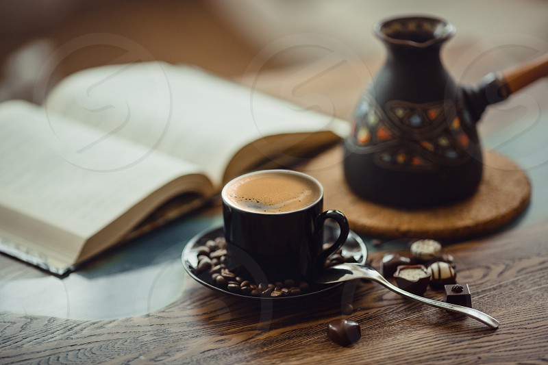 Coffee homeveranda story hot drink evening lay flat warm man morning table wood wooden spoon chocolate glass river muffin cocoa dark beans  coffeepot pot Turk spoon town city daylight  Black ceramic  photo