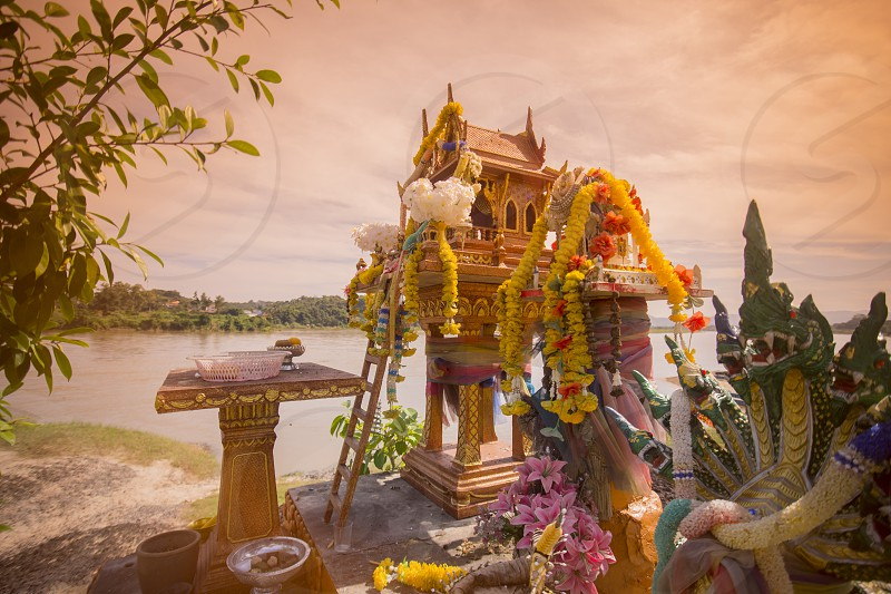a spirit house at the landscape of the mekong river at the town of Chiang khong the north of the provinz Chiang Rai in North Thailand. photo