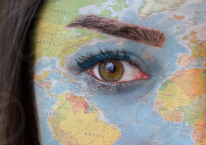 World map on woman's face photo