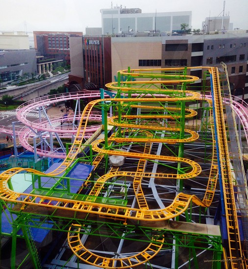 yellow and green and pink roller coaster photo