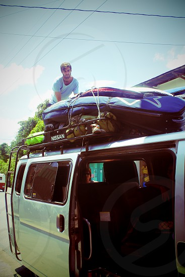 Too many surfboards not enough van photo