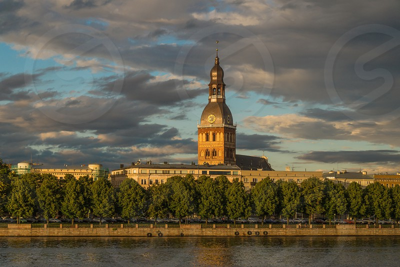 View of the Riga House Cathedral from the river side in a summer evening photo