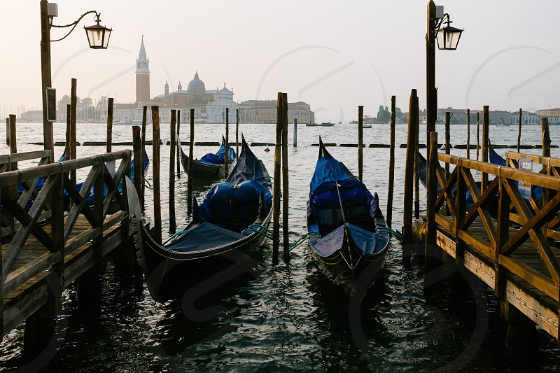 2 gondola boats by docks  photo