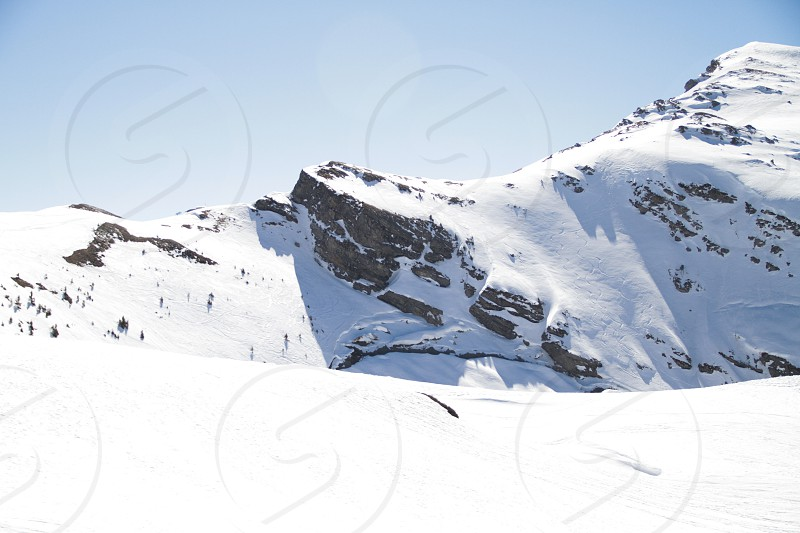 Mountain snow ski people lift pist sky cloud avoriaz trees sun sky photo