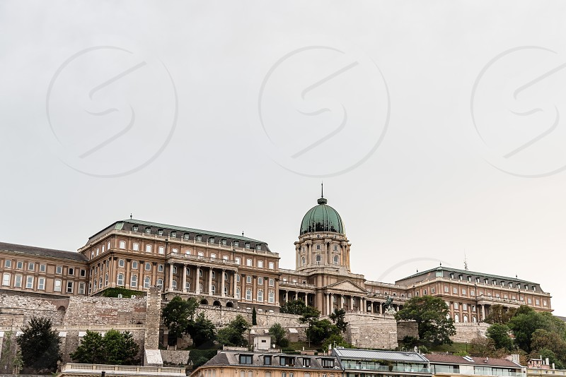 Budapest Hungary - August 12 2017:  Hungarian National Gallery. It is located  in Buda Castle. View from across the river Danube at sunset photo