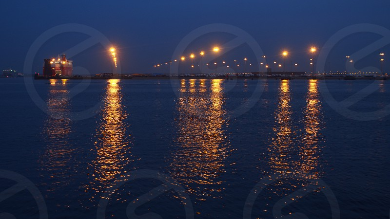 Car carrier Port of Zeebrugge Wallenius Wilhelmsen Car Carrier by night Lights Water Reflection photo