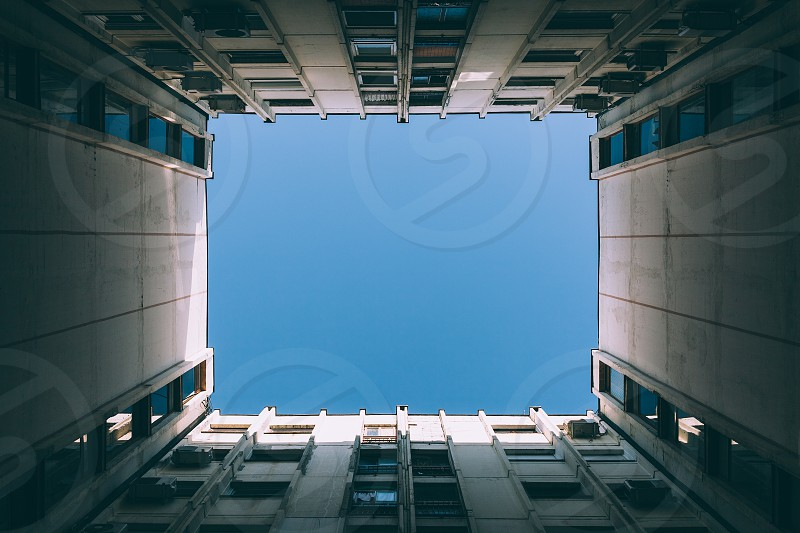 Low angle view of the sky between buildings photo