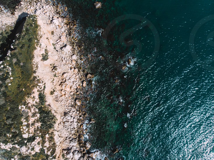 Aerial drone view video of sea near beach with birds fly Attica Greece photo