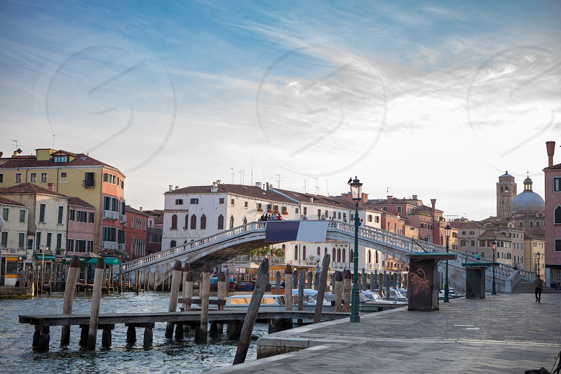 Picture of Venice as popular tourist destination of Europe. Beautiful view of Grand Canal with gondolas and colorful facades of old medieval buildings. photo