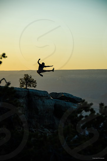 Silhouette fun chasing light casual jump Grand Canyon  photo