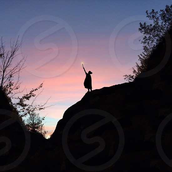 girl with wand silhouette hill photo photo