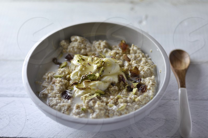 Porridge breakfast healthy cooking oats dates pistachios simple healthy eating  photo