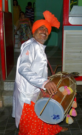 The sound of the dhol drum sets the festive mood during an Indian (Punjabi) wedding photo