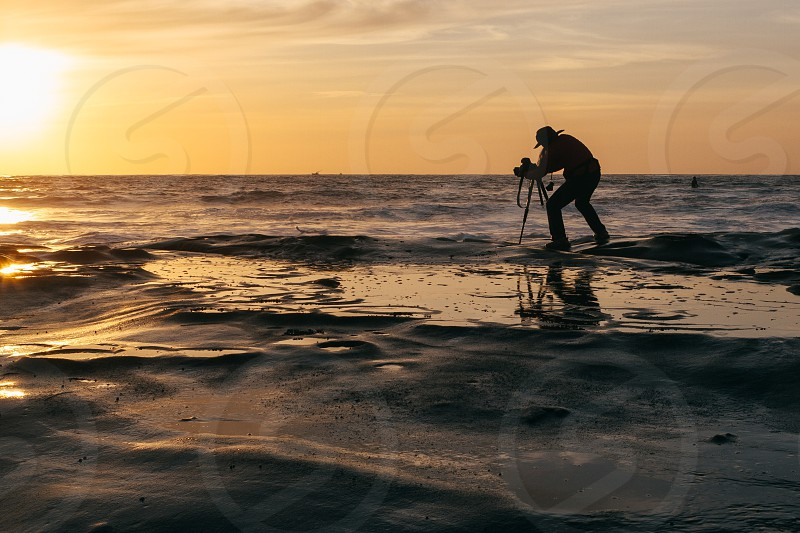 man in beach silhouette photo